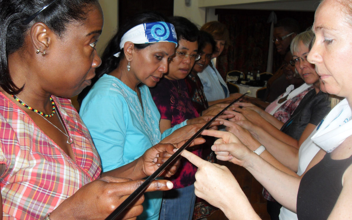 participants in women's leadership course doing a teambuilding activity