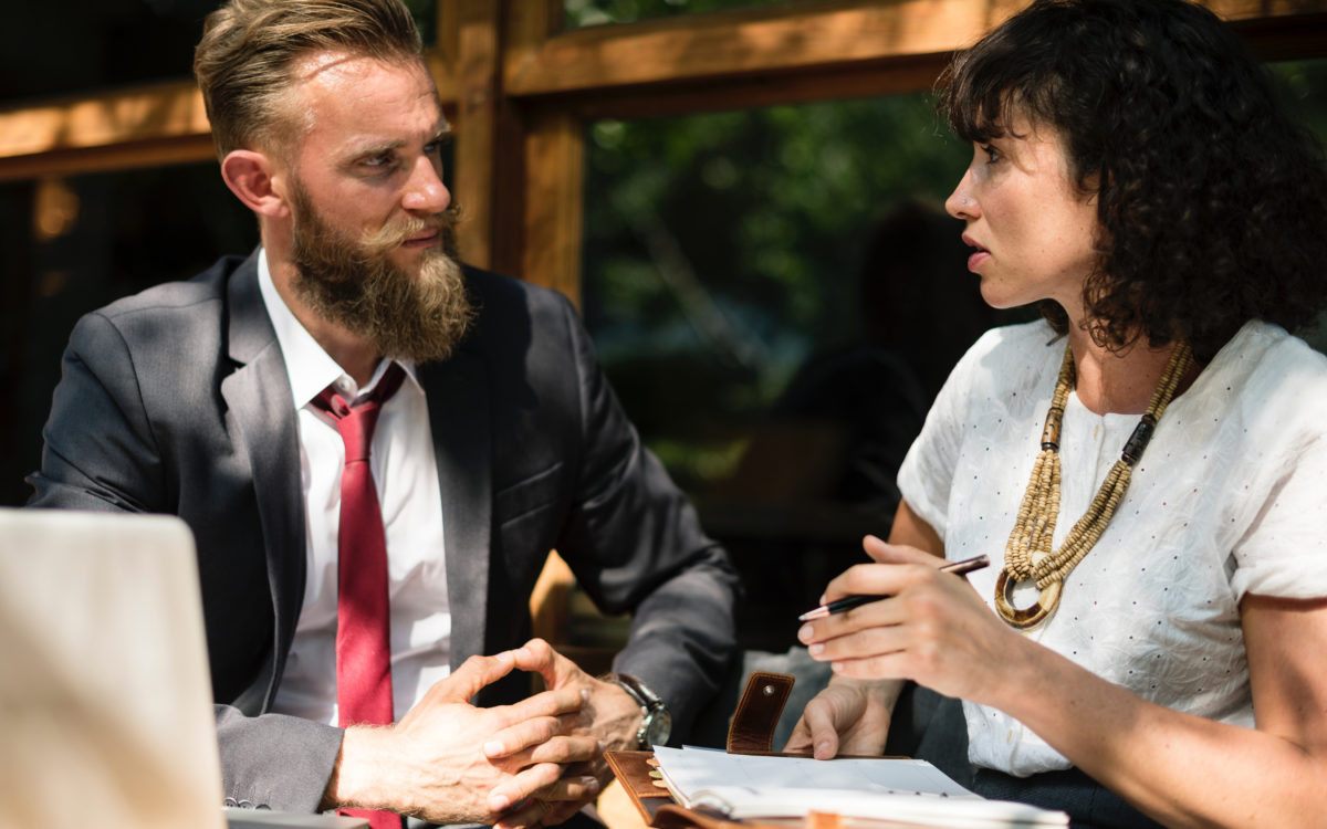 two people having a serious coversation meant to depict executive coaching